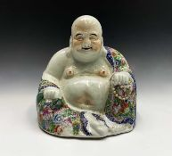A large Chinese porcelain figure of a seated Buddah, 20th century, wearing a floral decorated robe