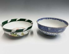 A Chinese blue and white bowl, circa 1900, decorated with a figure and a deer in a garden, with four