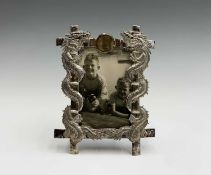 A Chinese silver photograph frame, circa 1900, signed HC and character mark, with a central plain