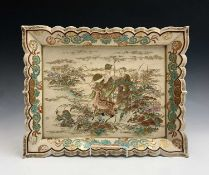 A Japanese Satsuma pottery wall plaque, Meiji Period, with figures and a deer amongst foliage, 35.