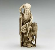 A Chinese carved ivory figure of Shouxing, 19th century, character marks, with staff in hand