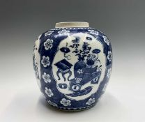 A Chinese blue and white prunus blossum porcelain ginger jar, 19th century, the four lobed panels