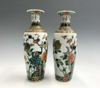 A pair of Chinese famille verte porcelain vases, Qianlong four character mark, with an exotic bird