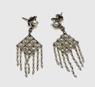 A pair of exquisite Belle Epoch platinum earrings of trellis form set with diamonds to the
