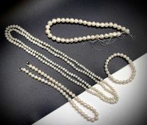 Cultured pearls - three necklaces and a braceletone continuous strand 122xmone chunky string of