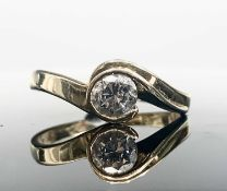 An 18ct gold diamond solitaire contemporary ring, the stone of approximately 0.4cts