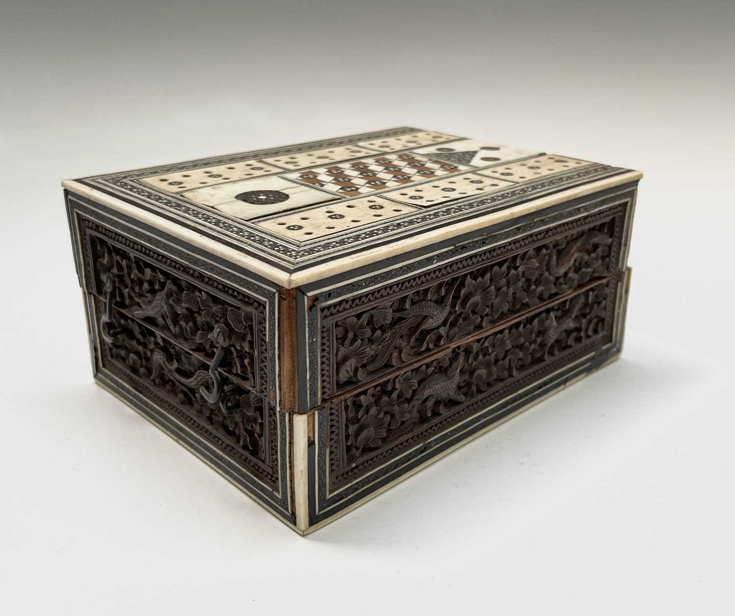 An Anglo Indian Vizagapatam and sadeli work banded folding cribbage board, 19th century, full length