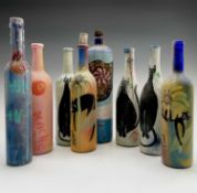 PONKLE (1934-2012) Eight painted glass bottles
