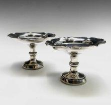 A pair of filled silver bonbon stands Birmingham 1928 Diameter 10cm