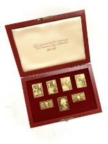A cased set of Coronation silver-gilt replica stamps