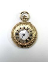 An 18ct gold cased half-hunter keyless fob watch 31.6mm diameter 29gmCondition report: Winds and