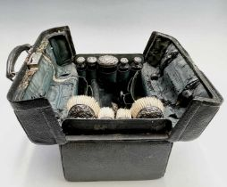 An Edwardian black leather toilet case with silver mounts hallmarked 1901 and 1902Condition