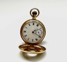 An 18ct gold half-hunter cased keyless fob watch by Waltham the Riverside Maximus movement with 19