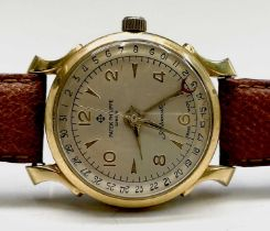 A gentleman's automatic watch with spurious makers name in gold plated case with sweep seconds and