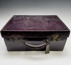 A purple leather toilet case by Mappin and Webb, the purple silk interior with silver-mounted