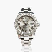 A Rolex ladies Oyster Perpetual Datejust Superlative Chronometer with diamond bezel, diameter 26.
