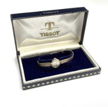 A ladies 9ct gold Tissot wristwatch on 9ct gold bracelet 16.2gmCondition report: This manual watch