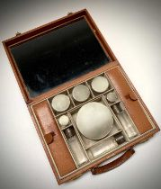 Asprey London ostrich leather gentleman's vanity case, with nine engine-turned silver-mounted