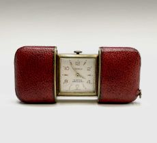 A Hermes 15 jewel purse timepiece in gold plated with sliding red leather case 53.2x35.6mm when