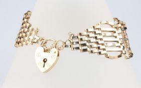 A 9ct yellow gold gatelink bracelet with heart padlock, 11.3 grams