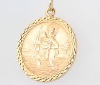 A 9ct yellow gold circular St Christopher pendant 5.7 grams