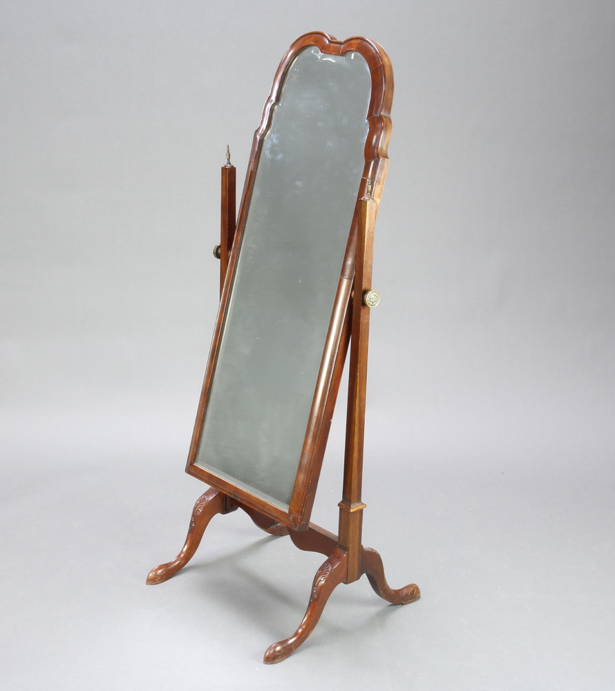 A Queen Anne style arched bevelled plate dressing mirror contained in a walnut swing frame 133cm h x