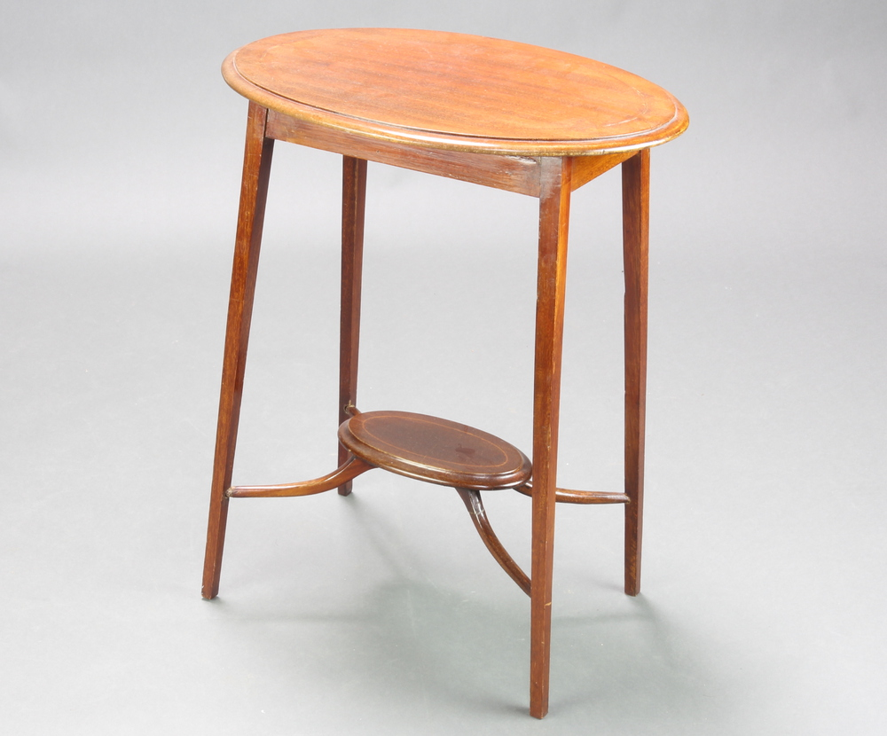An Edwardian floral inlaid mahogany 2 tier occasional table with shaped stretchers, raised on square