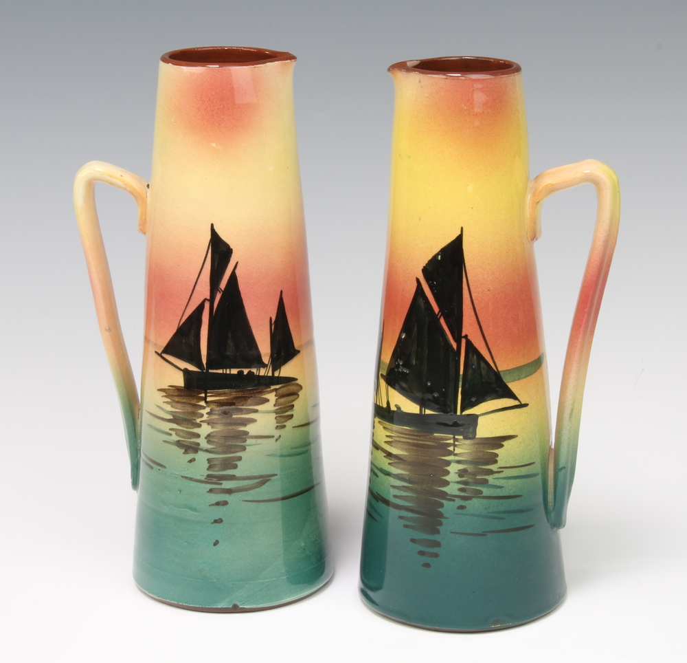 A pair of 1930's Devon Ware jugs decorated with sailing boats 24cm