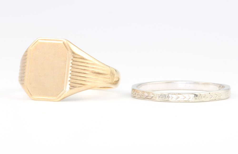A 9ct yellow gold signet ring 4.6 grams size R and an 18ct white gold wedding band 2 grams size Q