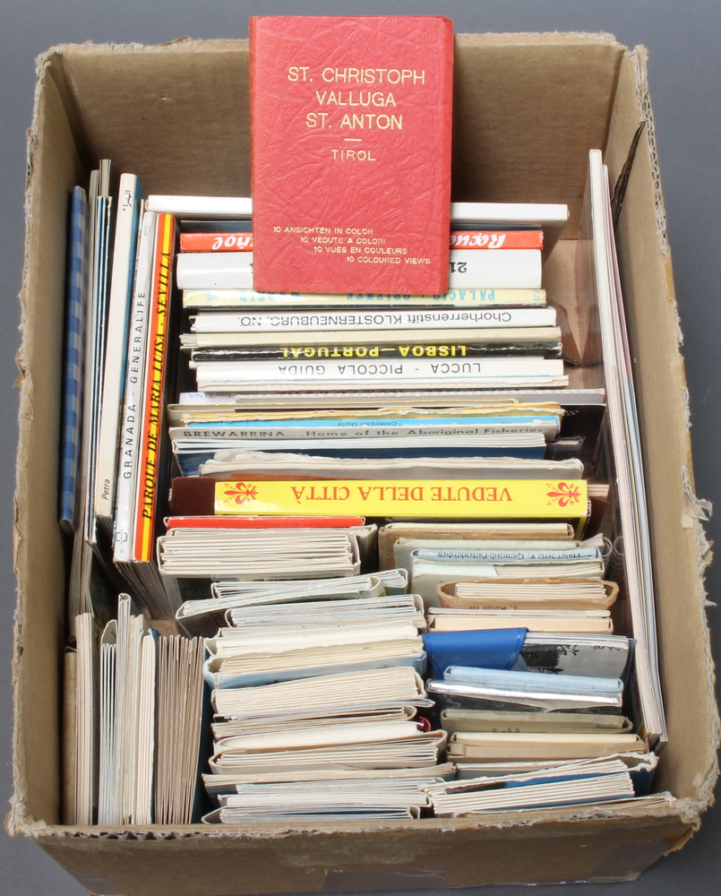 A box containing a collection of coloured Continental postcards