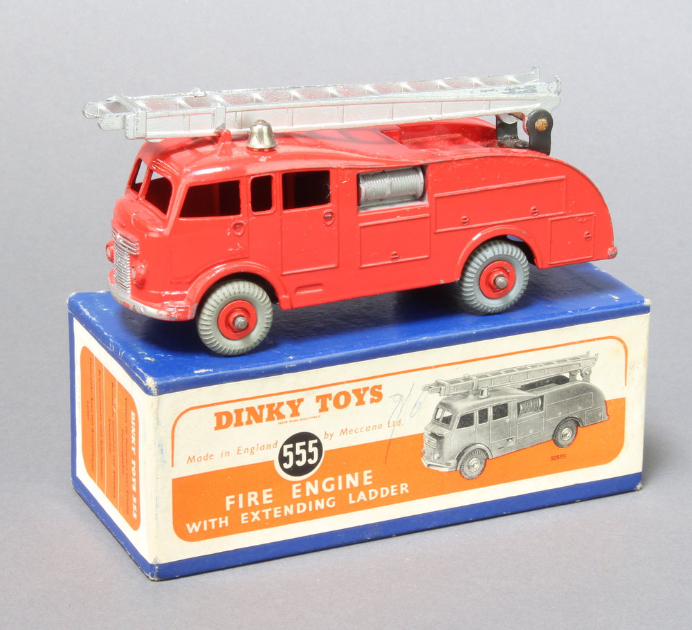 Dinky, a 555 red Fire Engine with extending ladder - boxed in blue with orange label.