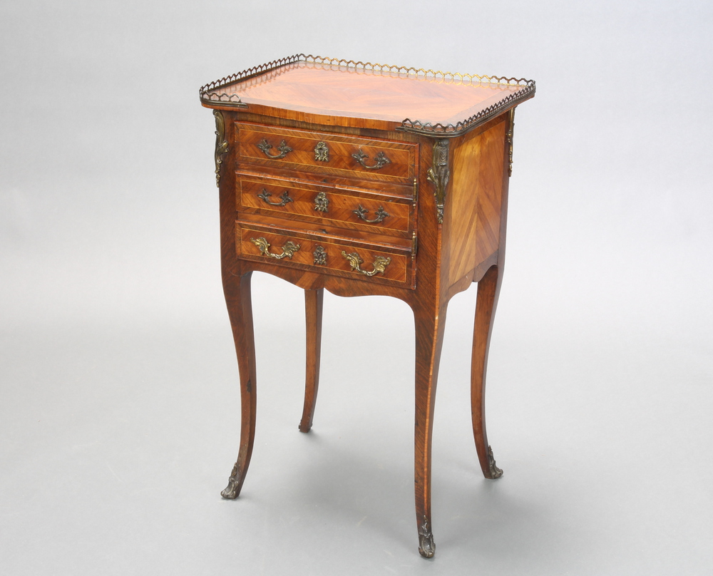 A French inlaid and crossbanded Kingwood bedside cabinet with quarter veneered top and gilt 3/4