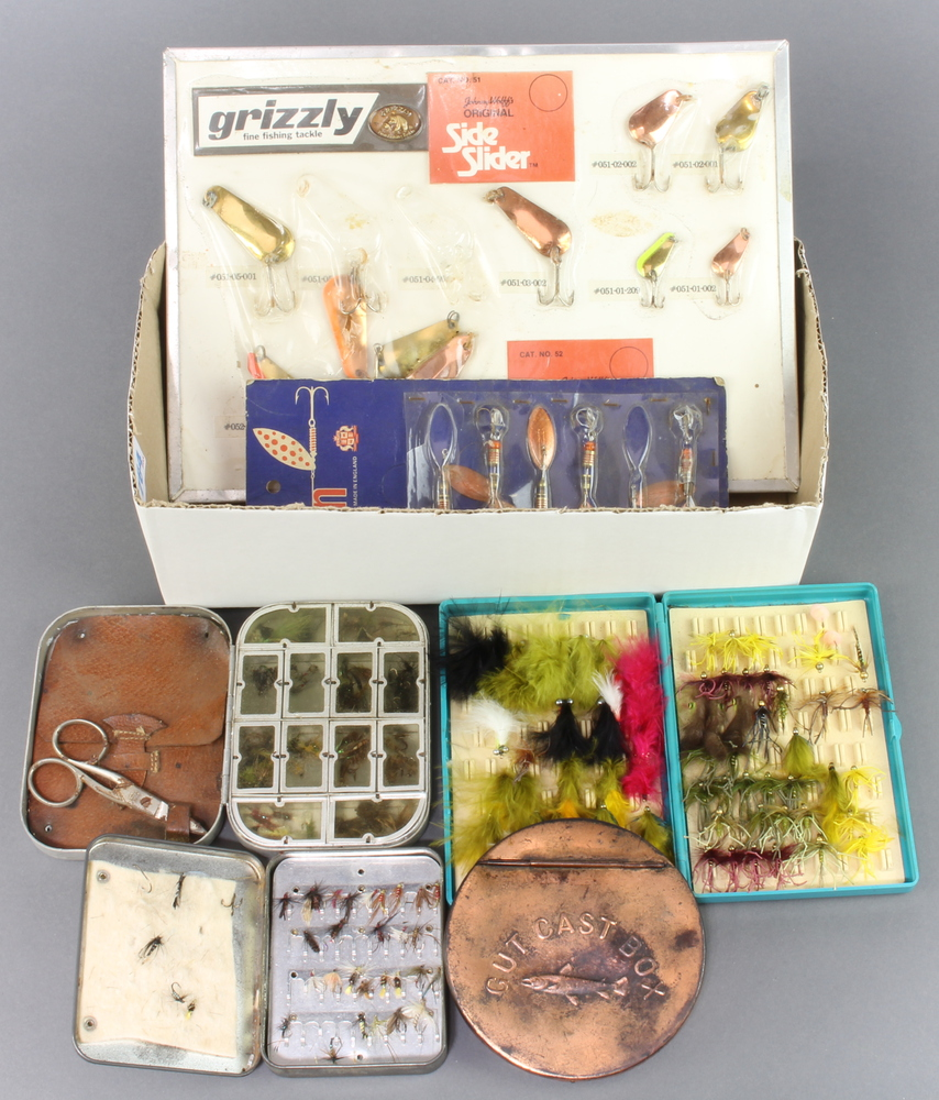 Two vintage trade cards with fishing lures, a Wheatley 12 window fly box, a Loch Leven trout fly
