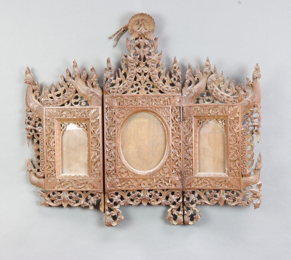 A 19th Century Burmese carved and pierced hardwood triptych photograph frame surmounted by a