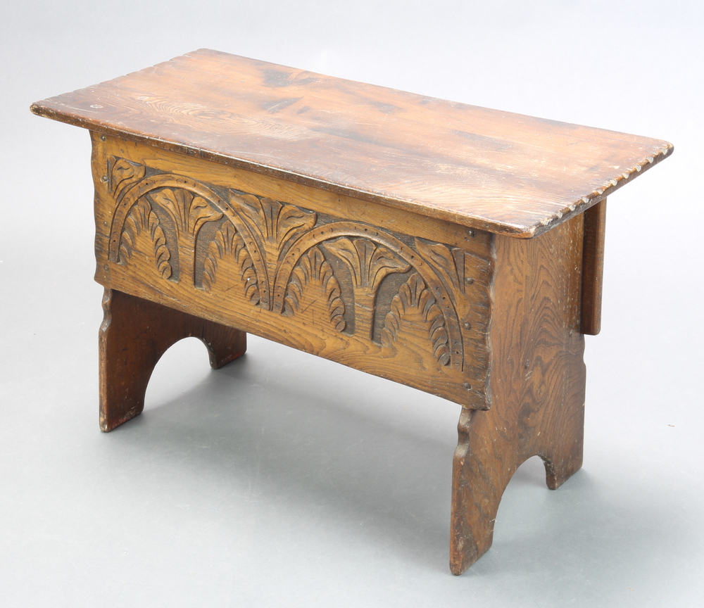 A 17th Century style carved oak coffer of panelled construction with hinged lid 48cm h x 76cm w x