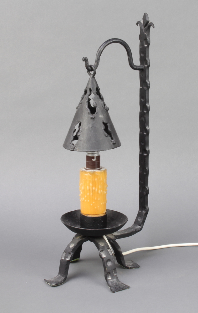 A wrought iron table lamp in the form of a 17th Century style candlestick with shade 40cm h x 18cm w