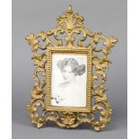 A Victorian pierced cast iron easel photograph frame, the back marked NO1009.P 30cm x 22cm