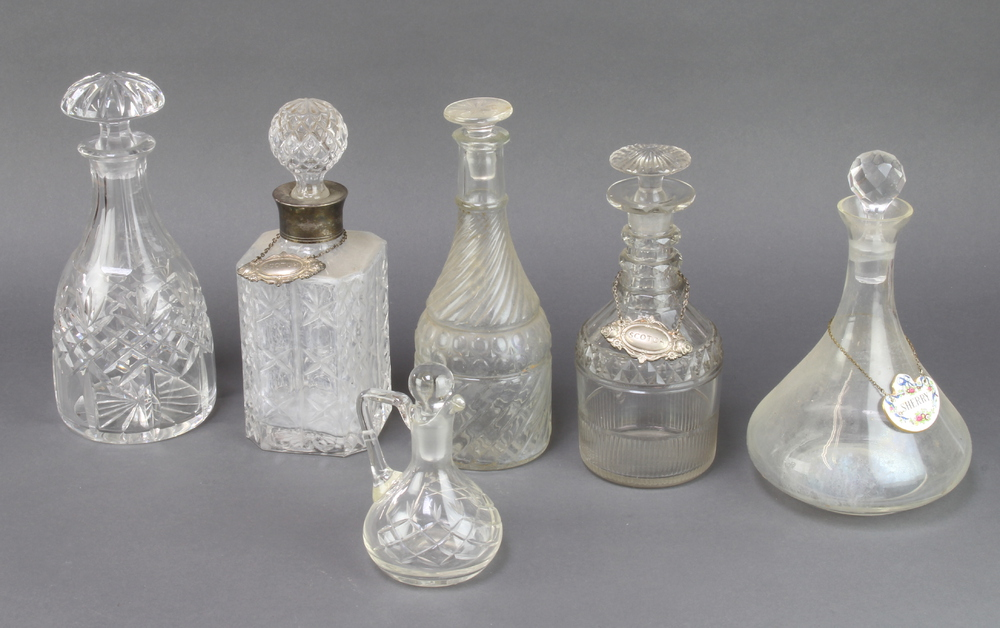 A square cut glass spirit decanter and stopper, a club shaped decanter and stopper, 3 other