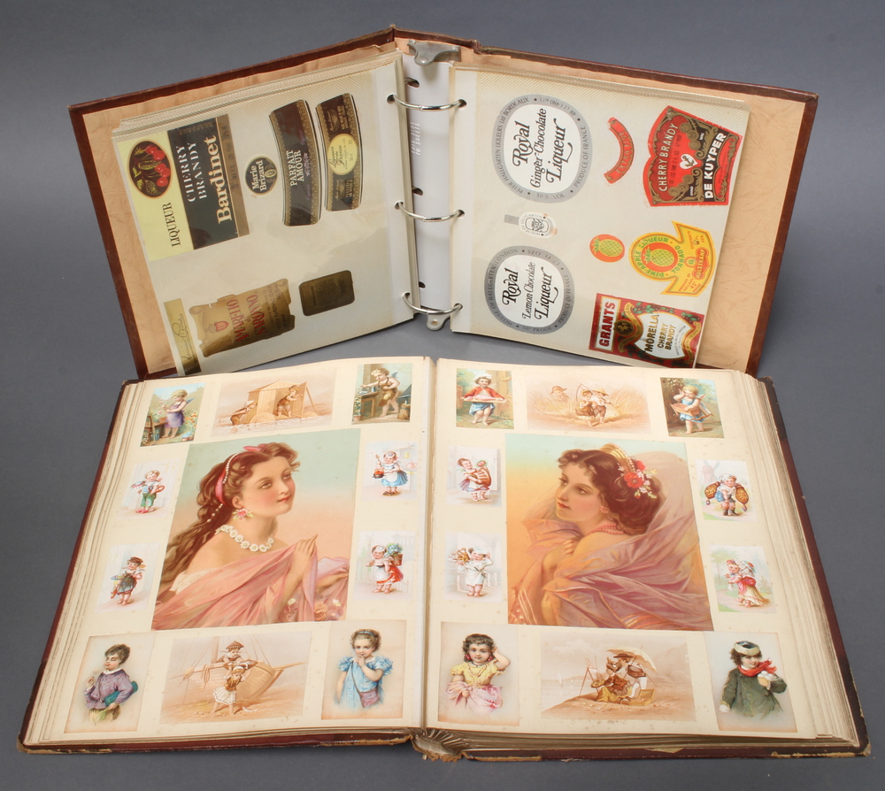 A Victorian coloured scrap album and an album of various wine labels