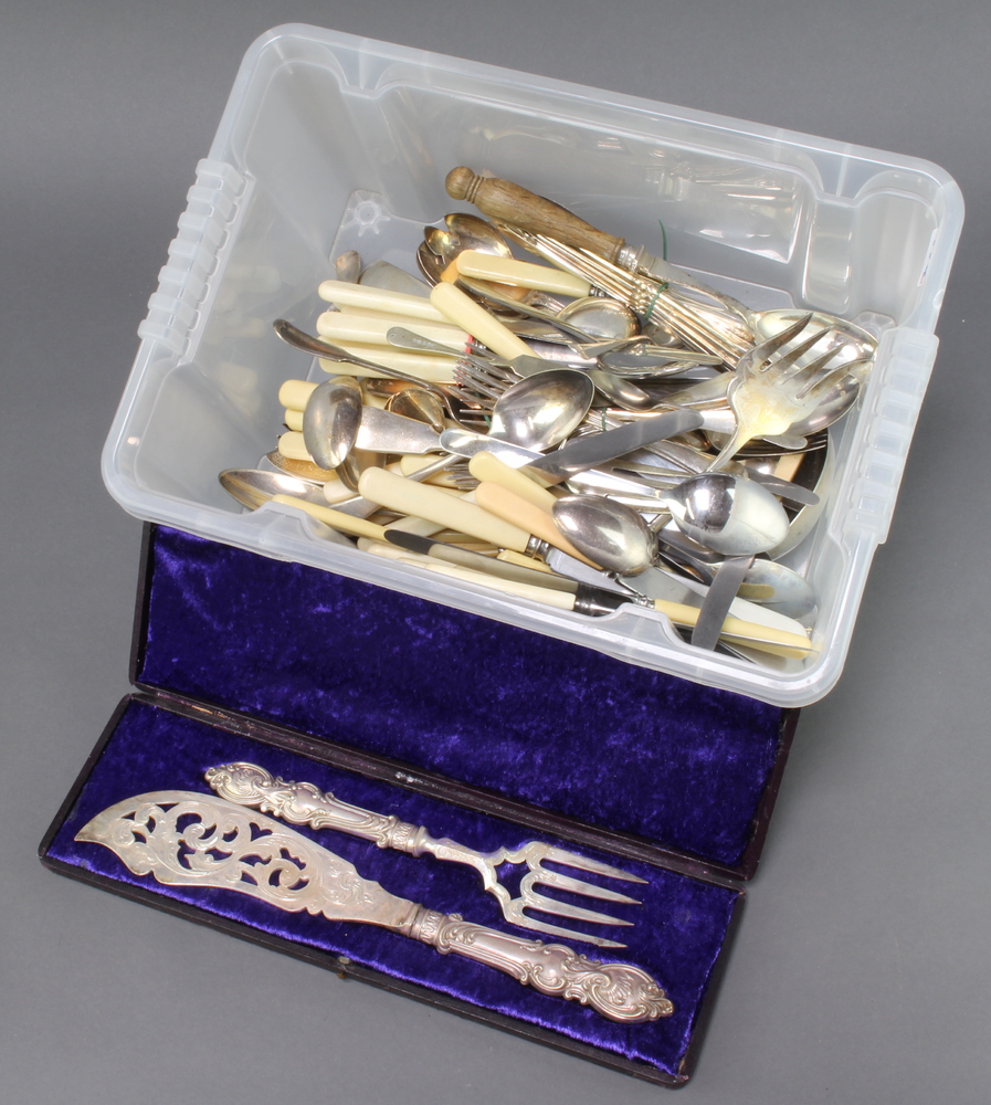 A cased pair of plated Victorian fish servers and a quantity of plated cutlery