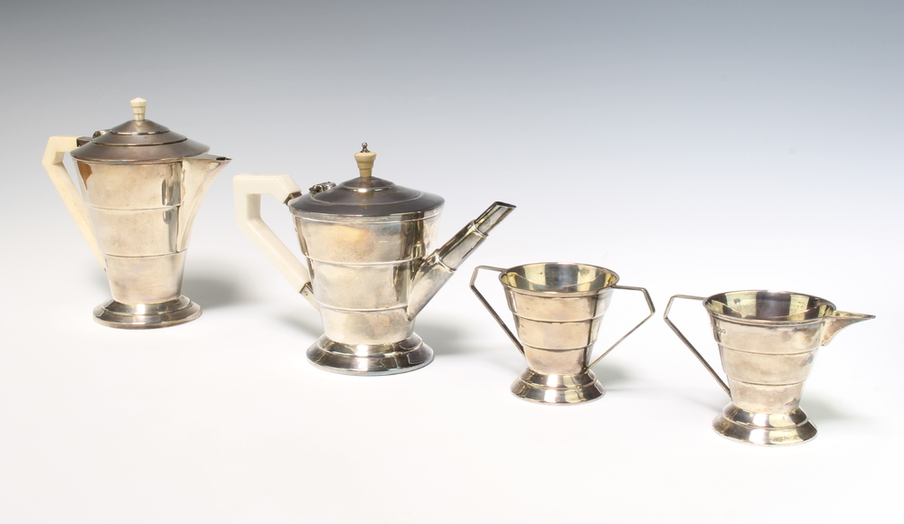 An Art Deco 4 piece silver tea set with ivory mounts, Sheffield 1934 and 1935, 1080 grams gross