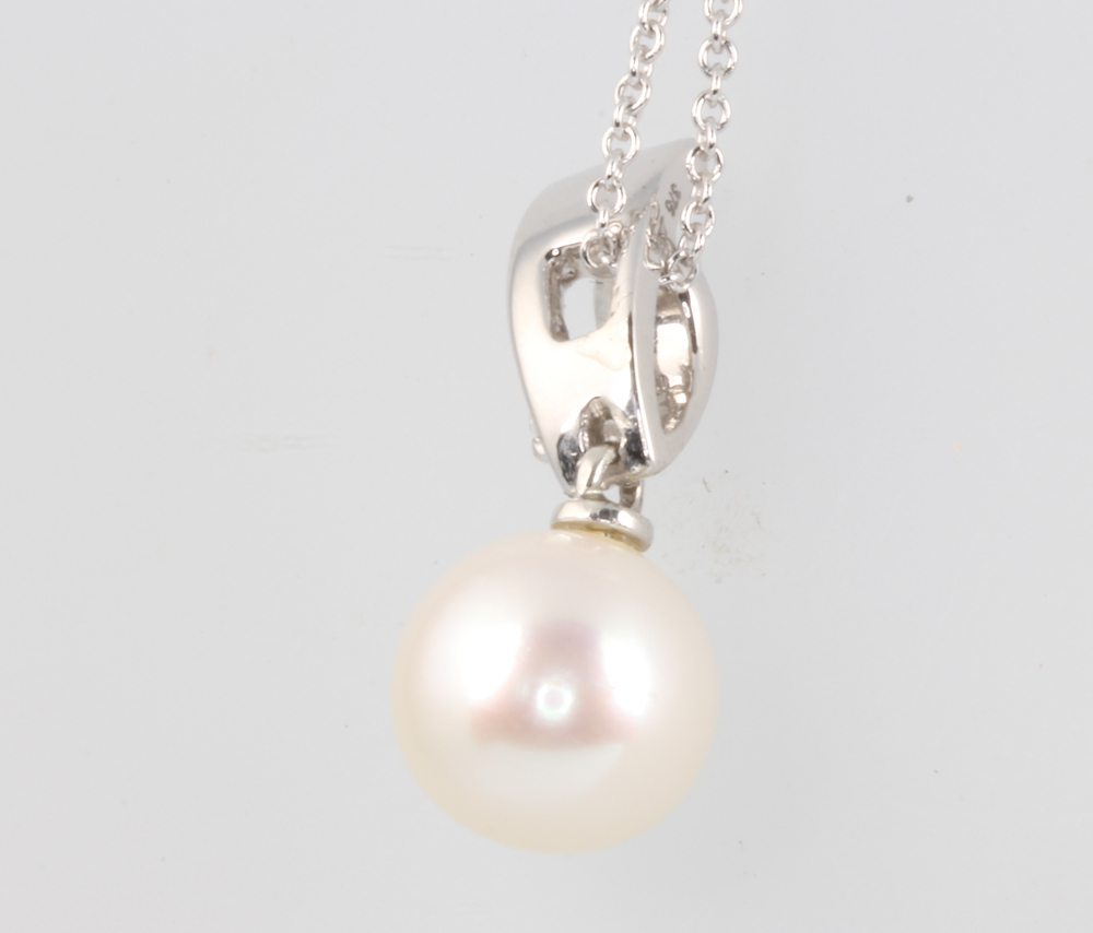A 9ct white gold pearl and diamond pendant on a ditto chain 3.4 grams