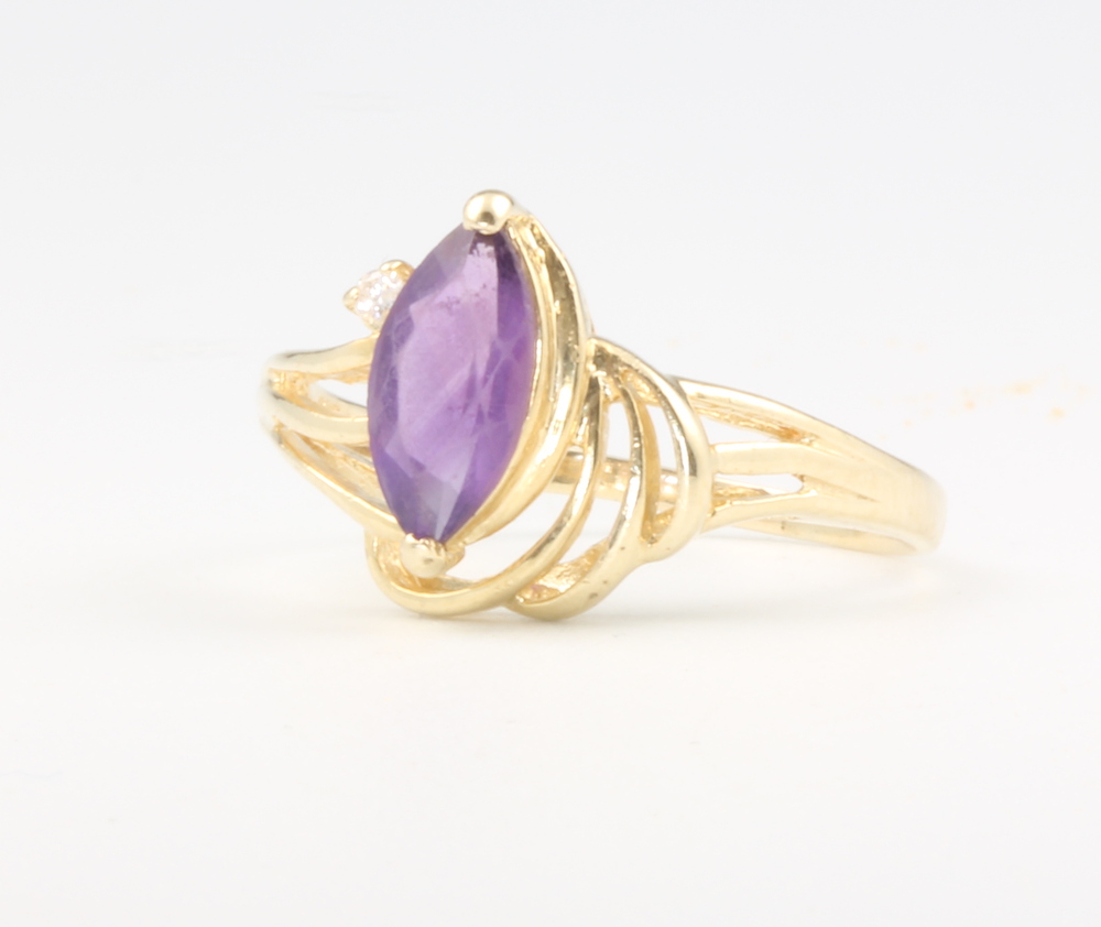 A lady's 14ct yellow gold amethyst and diamond scroll ring, 2.5 grams, size Q