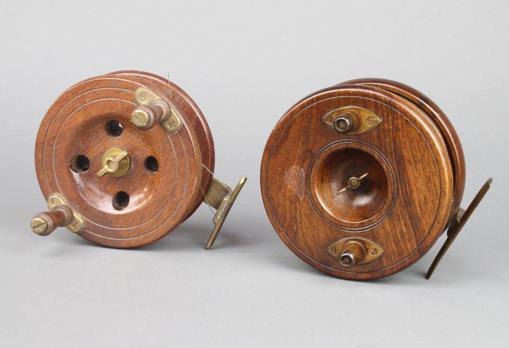 """Two Edwardian brass and mahogany 5"""" centre pin fishing reels"""