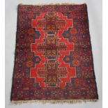A red and blue ground Belouche rug with 3 stylised diamonds to the centre 136cm x 85cm