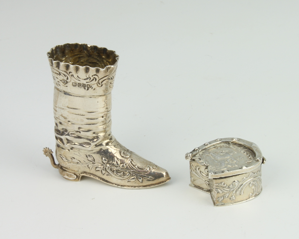 A Continental miniature silver model of a boot with floral decoration, import marks London 1898