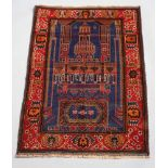 A blue and brown ground Belouche prayer rug with temple design to the centre 140cm x 92cm