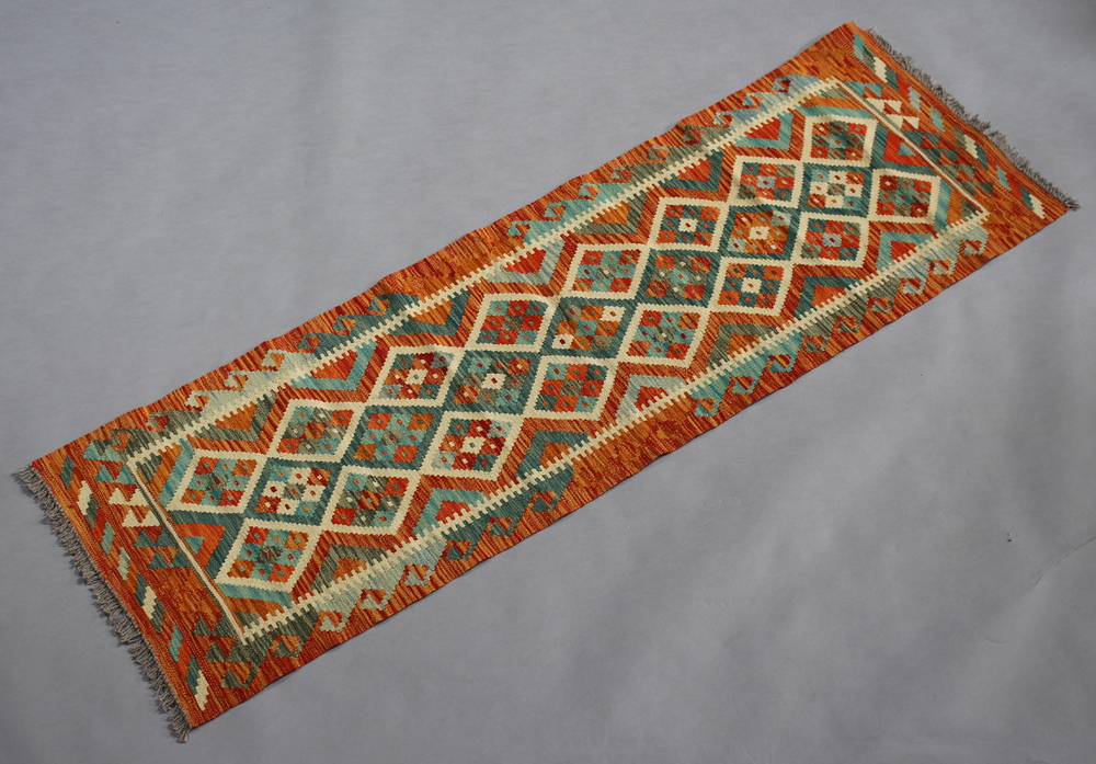 A white, green and gold ground Chobi Kilim runner with all over diamond design 192cm x 64cm