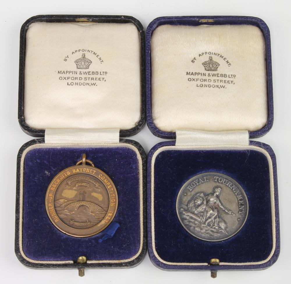 A 1933 silver Royal Tournament medallion and a bronze ditto, cased