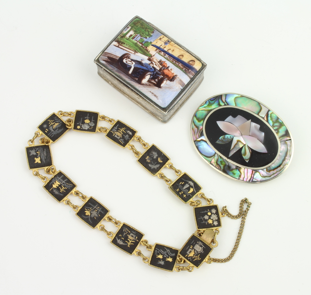 A modern silver pill box with enamelled motor racing scene 35mm, a bracelet and brooch